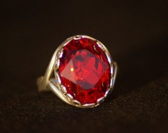 Antique silver ring with oval ruby rivulets