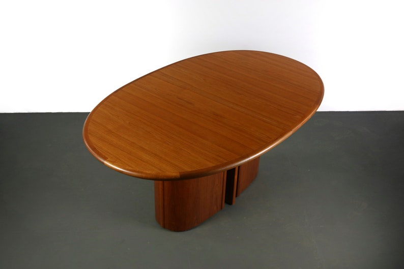 oval skovby dining table with butterfly leaf in rich teak