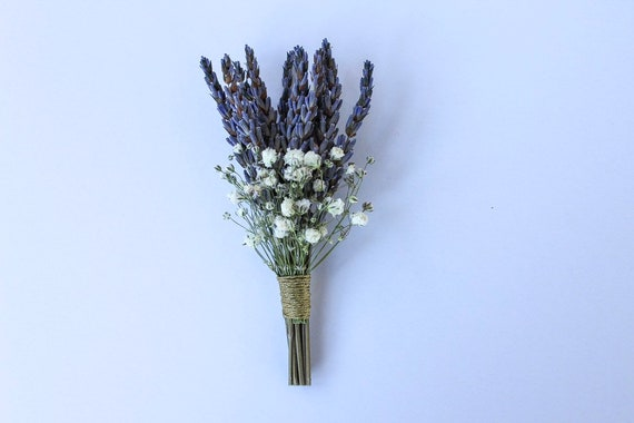 Yellow dried wildflowers with a sprig of lavender and evergreen boutonierre