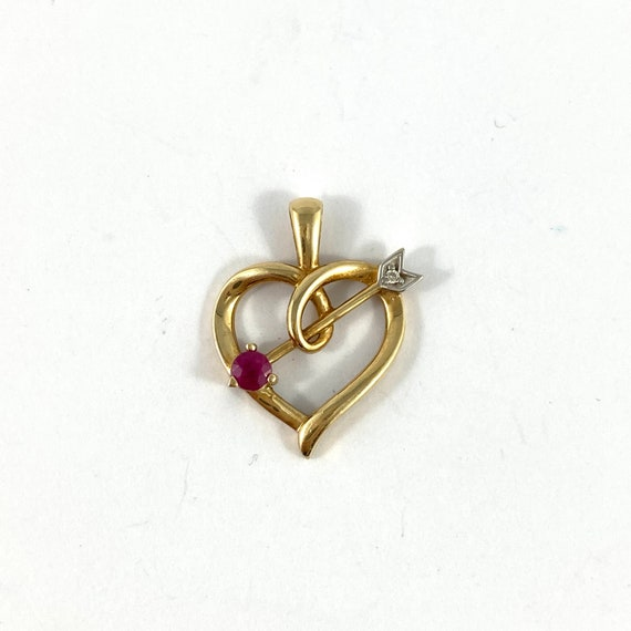 10K ruby and diamond, heart and arrow pendant, yel