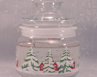 Christmas Candy Jar. Vintage Apothecary Glass Tidbit Jar w Lid, Plastic Grommet, Frosted Background, Snow Laden Trees, & Red Cottage. qjba