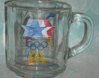 Vintage 1984 Olympic Games McDonalds Mug. 23rd Olympics Los Angeles CA White Cube Depicting Baseball, Volleyball, Basketball, & Soccer. pLbc