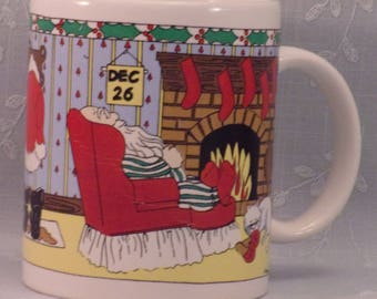 Vintage Funny Novelty Christmas Mug with Exhausted Santa Claus Sleeping on Dec 26th in Front of Fire Place in PJs and Wet Boots Drying. qJhb