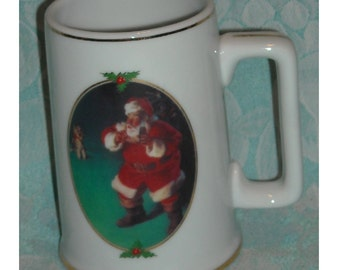 Ultimate Source Christmas Mug. Vintage Coca Cola When Friends Drop In 1996 Collector Edition Stein with Haddon Sundblom Art and Santa. Pd3b