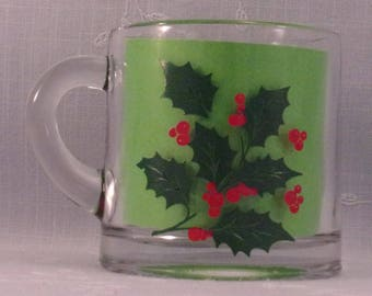 Vintage Indiana Glass Holiday Small Cup w Green Holly & Red Berries. Discontinued Clear Glass Christmas Pattern with Minor Paint Flaw. qJJb