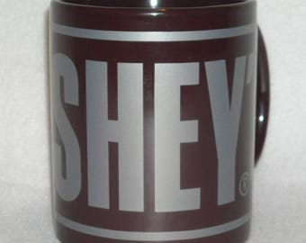 Collectible Hershey's S'Mores Mug. Promo Novelty Cup for the Cocoa or Hot Chocolate Lover. Dark Brown Background w Lg Silver Letters. Qggc