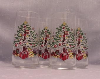 Vintage Christmas Glasses. 4 Clear Tapered Tumblers w Decorated Xmas Tree, Star on Top, Balls, Gifts, Teddy Bear, Drum, & Snowman. skaan