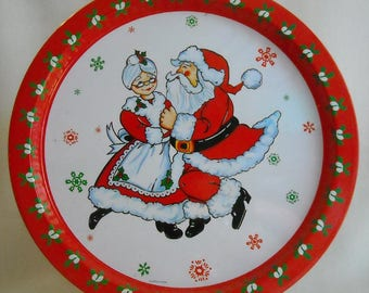 Vintage Christmas Platter. 1981 Giftco Holiday Metal Serving Tray w Santa & Mrs. Claus Dancing and Retro Floral Design on Border. niva