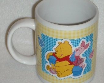 Vintage Disney Mug. Vintage Winnie the Pooh and Piglet Promo Mug w Gingham Background & Picnic Scene by Houston Harvest Gift Products. pdwb