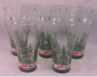 Christmas Glassware. 5 Libbey Tinted Green Tumblers w Enjoy Coca Cola Slogan, Pine Trees,  Small White Snowflakes, Holly, & Band. qkLc
