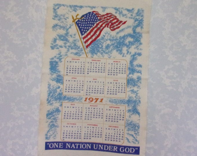 Featured listing image: Vintage 1971 Calendar. Linen Cloth 12 Month Wall Hanging Kitchen Tea or Dish Towel w American Flag & the words One Nation Under God. qLba