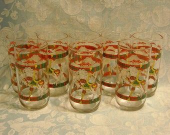 8 Vintage Christmas Glasses. Libbey 1990 House of Lloyd Tumbler Set w Pony or Horse Carousel, Tartan Plaid Band, and Red Ribbon & Bow. piva