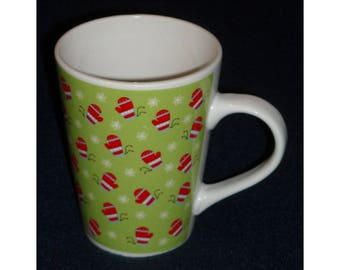 Christmas Mug.  Harbor East Tall Vintage Coffee Cup w Green Background & Red Mittens Around Cup and Let Us Entertain You on Bottom. Qgkc