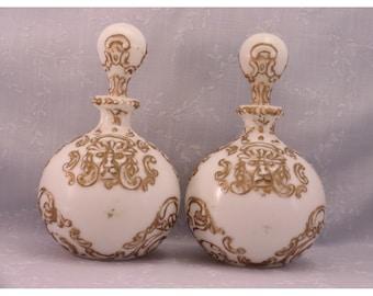 Antique Milk Glass Dresser Decanters w Original Stoppers. 2 Gillinder Gargoyle Vanity Bottles, also known as Lions Head Barber Bottles. Ri7a