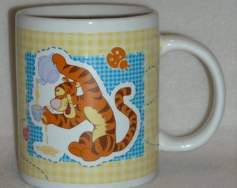 Vintage Disney Mug. Collectible Promo Cup w Tigger Having Fun, Small Lady Bug, & Gingham Background by Houston Harvest Gift Products. pdwc