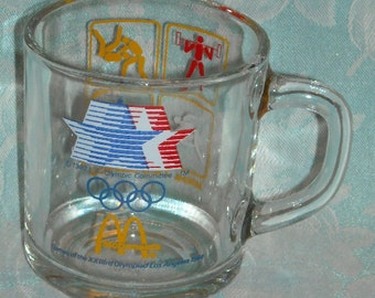 Vintage 1984 Olympic Games McDonalds Mug. 23rd Olympics Los Angeles Yellow Cube Depicting Weight Lifting, Wrestling, Track, & Archery. pLbd