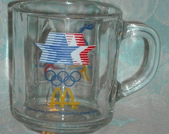 Vintage Olympic Games McDonalds Mug. 23rd Olympics 1984 Los Angeles White Cube Depicting Baseball, Volleyball, Basketball, & Soccer. pLbcu