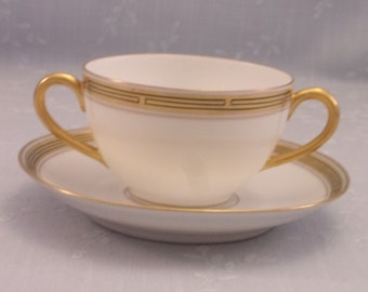 Antique Pickard China. Porcelain Cream Soup Cup & Saucer Set in Gold Decorative Geometric Pattern w 2 Handles on the Bowl. Set A. sjjao
