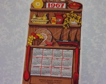 Vintage Calendar. 1967 Linen Cloth 12 Month Wall Hanging Kitchen Tea or Dish Towel w Promo, Wood Shelf, Chicken, Boat, Spoon, & Fork. qLbd
