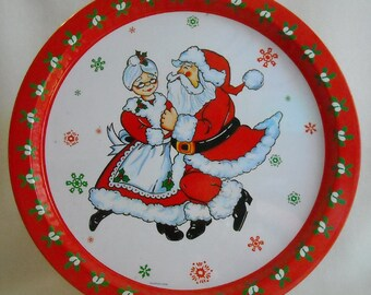 Vintage 1981 Christmas Platter. Giftco Holiday Metal Serving Tray w Santa & Mrs. Claus Dancing and Retro Floral Design on Border. niva