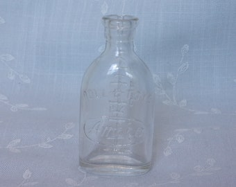 Figural Clear Vintage Glass Collectible Play Nursing Bottle. Marked Doll – E – Toys by Amsco w Numbers 1 through 6 Indicating Ounces. uisc