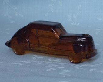 1940s Figural Amber Glass Candy Container. Vintage Victory Toy Miniature Streamlined Automobile Vehicle w Many Encased Bubbles. Uc8d ea33