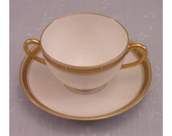 Pickard China. Antique Porcelain Cream Soup Cup & Saucer Set in Gold Decorative Geometric Pattern w 2 Handles on the Bowl. Set B. sjkao