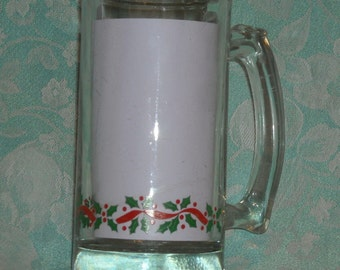 1 Libbey Vintage Christmas Stein. Holly and Berry Clear 5 1/2 Inch Tall Mug w Green Holly Leaves, and Red Ribbon & Red Berries Band. rs