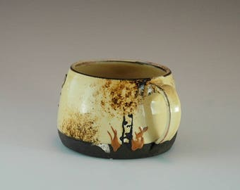 Handmade cup yellow on black clay with nature movite.