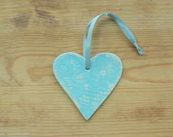 Ceramic heart ornament - large and with lace pattern.