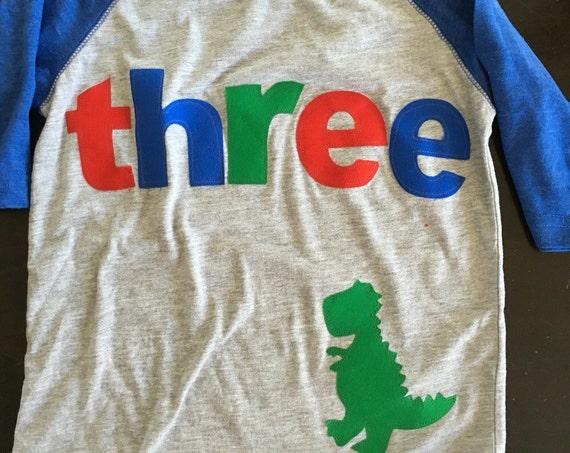 t rex birthday shirt, boys three dino birthday shirt, 3rd birthday dinosaur shirt, raglan style shirt red blue green