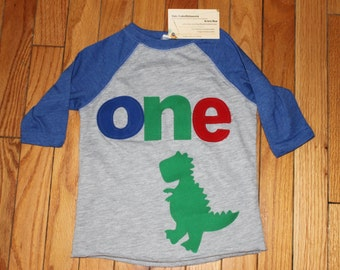 ONE T Rex dinosaur boys 1st birthday shirt, boys dino birthday raglan shirt  primary colors, 1st birthday dinosaur shirt, red blue green boy