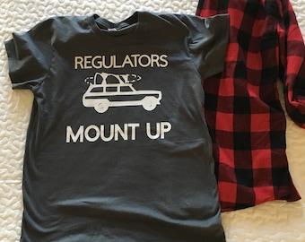 Regulators Mount up rap song Christmas graphic tee shirt, station wagon with Christmas tree