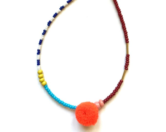 Pipsan Orange Pom Pom Bracelet