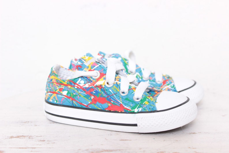 0bcb4289c618 Used Toddler Blue Low Top Splatter Painted Converse Sneakers