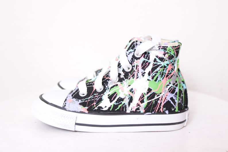 ba07e852aa29 Toddler Black High Top Splatter Painted Converse Sneakers
