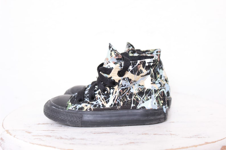 18ac826cae45 Used Toddler Black Out High Top Splatter Painted Converse