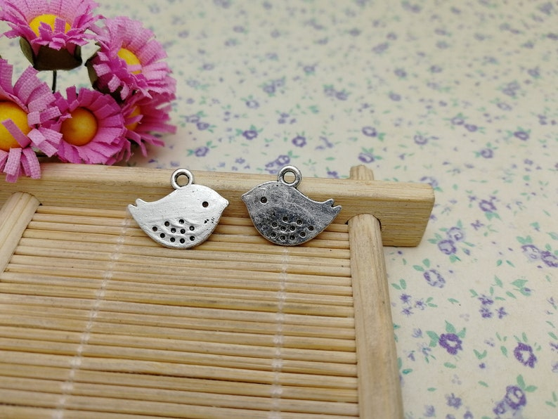 50pcs antique silver color 16x13mm metal bird pendant charm handmade craft jewelry making DIY finding earring necklace drop BM176