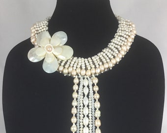 Long dangling pearl necklace