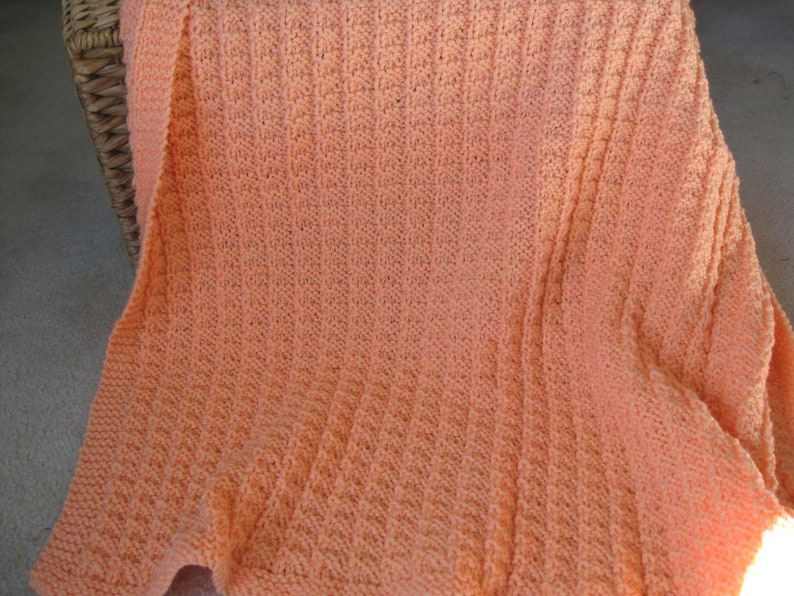 Sherbet orange hand knitted baby blanketthrow