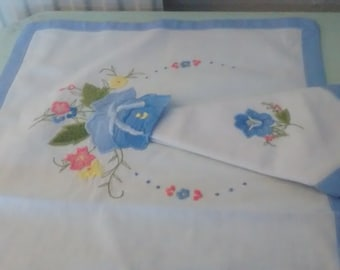 Two Table mats with matching serviettes.