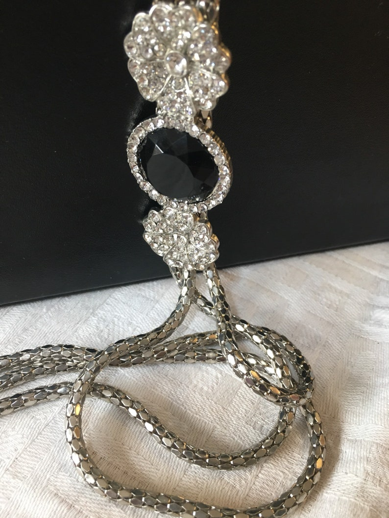 Three strand chain necklace with diamante clasp