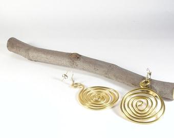 Golden geometric aluminium earrings. Long earrings. Everyday earrings. Spiral earrings.