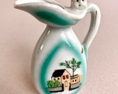 Rare Find Vintage Miniature Ceramic Vase With Baby Face And Painted House Made in Japan collectible