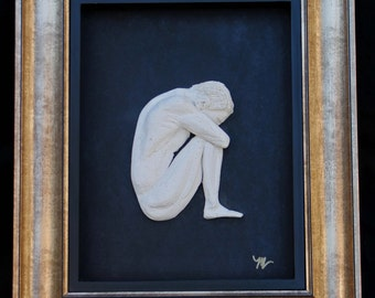 Framed Ceramic Bas Relief Sculpture of Seated Man