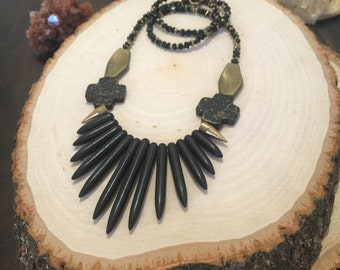 black and gold tribal spike necklace. bohemian fringe statement necklace. modern rustic dagger bib necklace. howlite spike necklace.