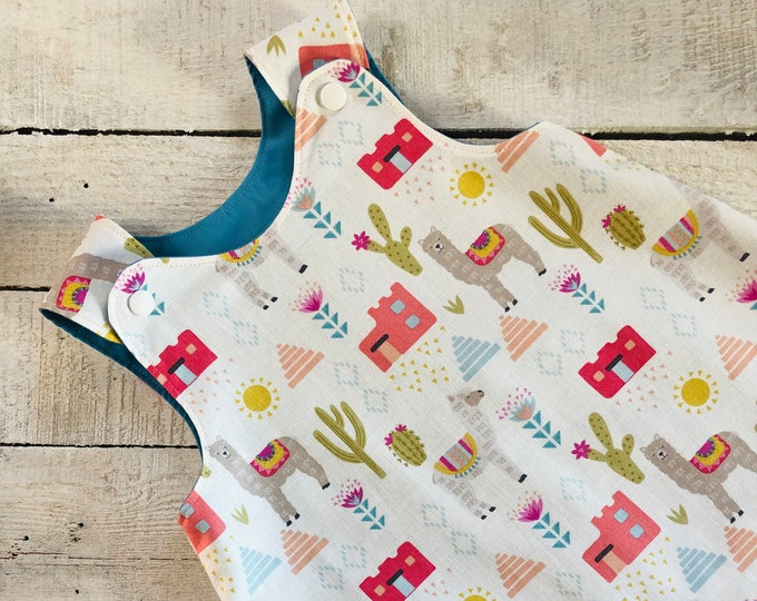 Little girls reversible pinafore dress tunic- cream cactus llama fabric, lined in turquoise blue,  baby shower gift