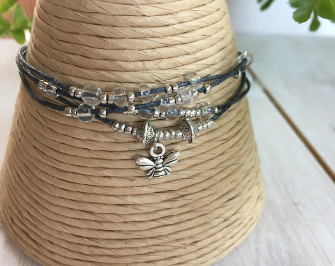 Butterfly charm, silver tone and clear bead, cord bracelet, handmade and fair trade