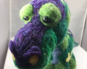 Brent the Whimsical mosaic dinosaur is ready for your home.  Made with TLC
