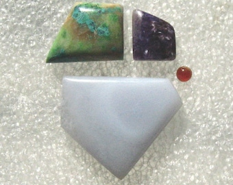 Group with Blue Lace Agate, Parrot Wing Jasper, Charoite, and Carnelian